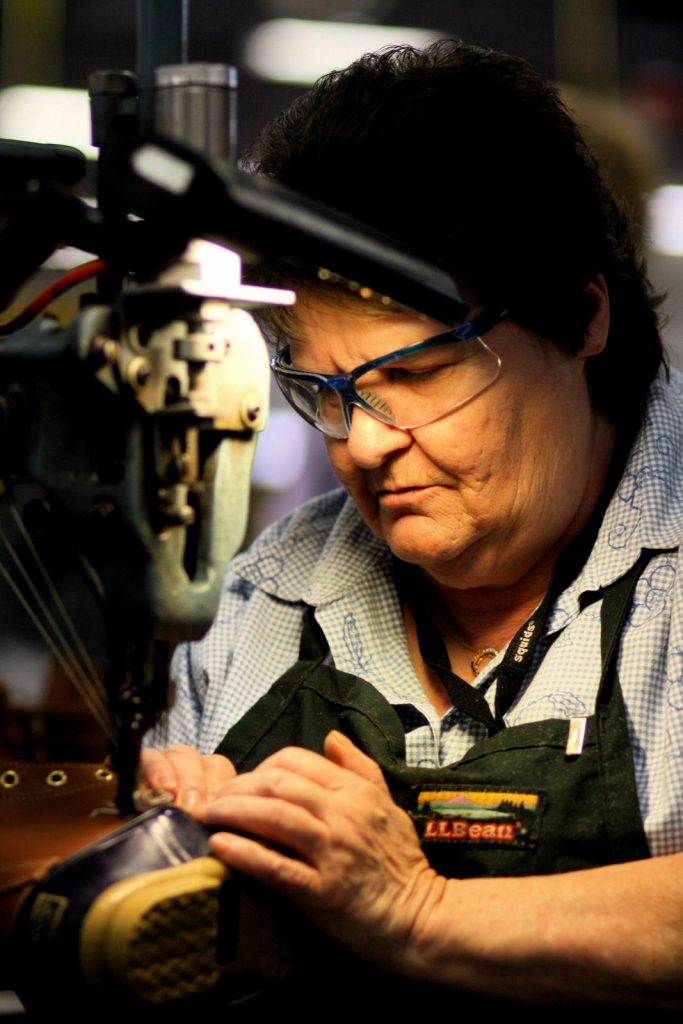 Applying the trademark triple-stitch to a pair of L.L. Bean boots